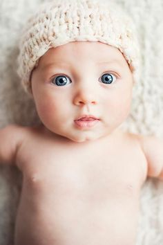 OMG beautiful baby eyes. Makes me wish we would have gotten a professional shoot when Eva was this tiny.