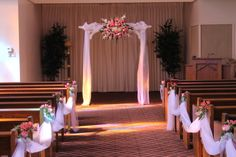 Arch and aisle. Pink and white