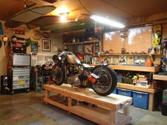 Convert Your Garage into a Man Cave - Man Cave Home Bar Motorcycle Workshop, Motorcycle Shop, Motorcycle Garage, Man Cave Garage, Garage Shelving, Garage Storage, Shop Storage, Shelving Ideas, Storage Ideas