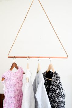 copper pipe and rope hanging clothes rack