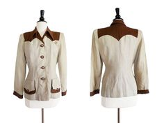 1940's women.s suit jacket in cream and brown. Highly tailored details.