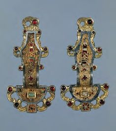 Looped Fibulae Silver gilt worked in filigree w/inlays or garnets & stones