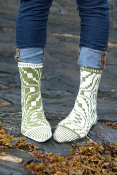 Construction Notes: These socks are worked from the cuff down in stranded colorwork with a V-shaped heel. The colorwork pattern is given in chart form only. While shown as an unmatched pair, you could make a matching pair if you prefer.