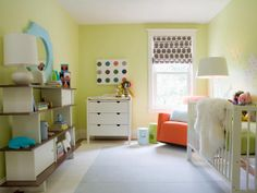 Modern & Stimulating If you want to incorporate bold colors in a nursery, design a room with soft neutrals first. The soothing green walls and light-blue carpet tiles provide the perfect foundation for this nursery. The orange rocker pops in the corner, and colorful accessories and toys are bold yet functional accents.