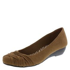 """This perfect-for-work wedge features a soft, faux suede upper, round pleated toe, jersey lining, padded insole, modest 1 1/4"""" wedge, and a durable outsole. Manmade materials."""