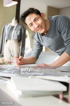 Fashion designer drawing sketch