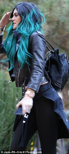 Showing the how it's done! Kendall and Kylie Jenner we edgy chic as they joined sister Kou...