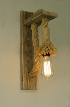 A combination that comes from the old days. Wall Lamps made of reclaimed wood with rope finish. This marrying of materials creates in the space sweet nostalgic and warm atmosphere. It is for installation of a power supply that exists on the wall, but if you wish you can get plugged in and ON OFF switch, suffice to contact me. Lampholder E27 (E26 for USA) Bulb shown is not included. Accept any commercial lamp to 40 watts. Sconce measures17 (43cm)high, 3.9(10cm) wide and sticks out…