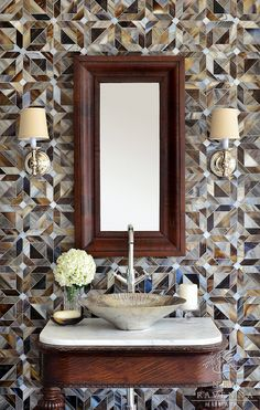 Chic powder room with 'Rubric' mosaic tile from New Ravena's parquet line by Sara Baldwin and a modern sink mounted on an antique table base.