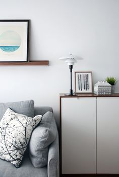 Sofa And Louis Poulsen Table Lamp