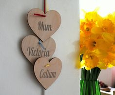 personalised hanging hearts by creative and contemporary handmade   notonthehighstreet.com
