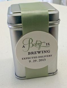A Baby is Brewing Tin Favors. Choose tea or coffee; unisex green (pictured) or choose baby blue or girl pink. Tags personalized. Comes assembled or DIY kit by ideachic