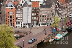 City of Amsterdam, historic row houses from above, corner of Bloemgracht and Prinsengracht streets, Holland, Netherlands.