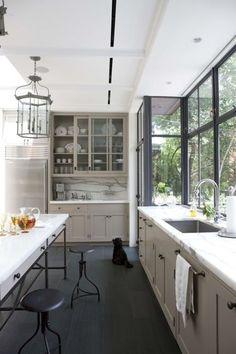 {Kitchen} White quartz countertop with calacatta countertop.