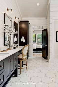 In this master bathroom, rich black cabinets provide plenty of storage and style when combined with the marble hex tile floors and white shiplap on the walls. Black And White Master Bathroom, White Bathroom, Bathroom Ideas, Modern Master Bathroom, Bathroom Signs, Shiplap Master Bathroom, Small Bathroom, Master Bath Tile, Minimal Bathroom