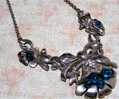 Mid Century flower ribbon motif necklace Turquoise blue glass balls and crystal rhinestone highlights Silver tone setting 16 inches long, centerpiece is 4 inches long with a 1 1/2 inch drop Very good vintage condition, shows no wear I specialize in vintage rhinestone jewelry, please visit my shop to see more International buyers welcome, overcharges are refunded Flat rate priority shipping is optional 40517  Credit cards and Paypal accepted.  Want to see more great necklaces? Click here:...