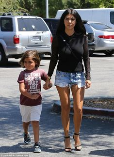 Looking slim: 36-year-old Kourtney and her son Mason also went with Kim to a local health ...