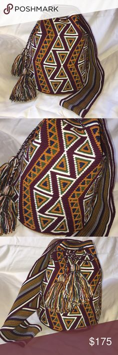 """Finest Wayuuchilabags bucket bag fall colors One of a kind bag. New, never worn. EXCELLENT QUALITY NEW WAYUU MOCHILA LARGE SIZE BAG, TIGHT STITCH CROCHET, WASHABLE COLORFAST COTTON, HANDMADE BY THE WAYUU SEMI-NOMADIC CULTURE IN VENEZUELA & COLOMBIA THESE MOCHILAS TAKE APPROXIMATELY 25 DAYS TO MAKE 100% BY HAND WITH 1 NEEDLE THREAD. CLOSES WITH DRAWSTRING. And tassel ends colors: ivory, yellow, orange, navy & purple in geometric sun pattern DIMENSIONS: HEIGHT : 11 inches DIAMETER: 9"""" STRAP…"""