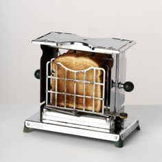http://lindacee.hubpages.com/hub/Toasters-of-the-1920s~~~~~The Swinger, this toaster was unique because the cages swung around to toast both sides, and the bread was distinctively branded. The first four slice toaster was a swinger, these were a hot seller !!