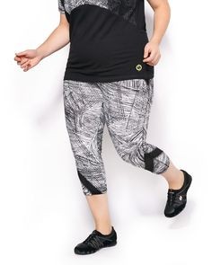Get moving in this stylish plus-size activewear capri legging! Its super soft and stretchy cotton blend fabric features a moisture-wicking treatment for comfort and breathability. It has a comfortable wide waistband, trendy abstract print and sheer mesh inserts. Wear it with its matching activewear t-shirt for all your physical activities!