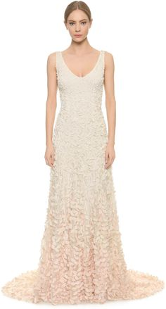 Theia Emma Embroidered Petal Gown Graduated appliqués create an ombré effect on this Theia gown, offering a textured take on the column silhouette.
