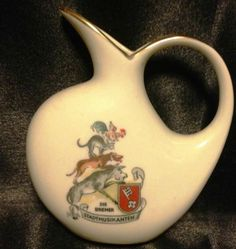 "The Town Musicians of Bremen (German: Die Bremer Stadtmusikanten) this a cute & small double-marked Gerold Porcelain creamer.pitcher with artwork(including The Bremen coat of arms with a picture of animals balanced atop one another) based on the folktale recorded by the Brothers Grimm', PITCHER 4"" TALL WITH gold HIGHLIGHTS"