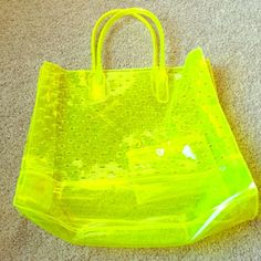 "Juicy Couture  Neon Large Plastic Tote Adorable Juicy Couture Neon Large Plastic Tote - Never been used, but does have some super minor scuffs on the bottom of tote, not noticeable when wearing it tho - approximately 17 1/2"" W x 15 1/2"" L - also has a removable pouch inside to hold smaller items - perforated with crowns on both sides of tote - SO adorable!! Perfect for the beach or gym - bright neon yellow color  Juicy Couture Bags Totes"