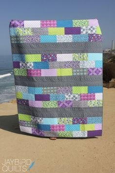 Skip the Borders – Jaybird Quilts. Love the bright colours with grey sashing.