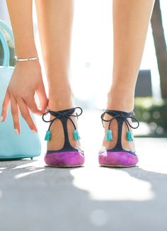 purple and navy suede pumps with turquoise aqua accent tassels