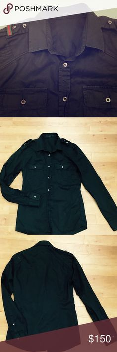 Auth Gucci black button down shirt (Price Firm) Gucci...Gucci...Gucci. Basic black button down shirt that is now anything but basic with the signature green/red Gucci stripes on shoulder. Every single button says Gucci on it also❤️EUC. (Price Firm). Gucci Shirts Casual Button Down Shirts