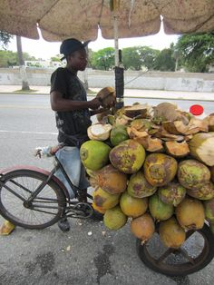 Coconut seller in streets.  DOMINICAN REPUBLIC