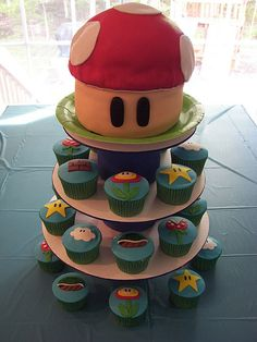 I don't know about the little cupcakes but the big mushroom would be easy to make with one of those giant cupcake pans