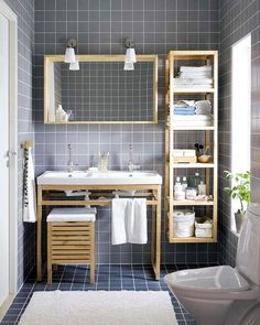 One of the smallest rooms is usually the bathroom and finding space to store the stuff we want and need in a bathroom can be a challenge. Love the open shelving and wood of this tiny home.