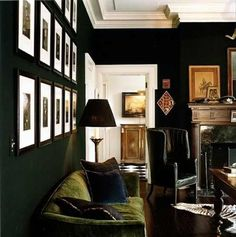 love the green velvet couch with the black walls