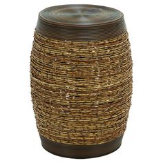 Add an extra seat around the coffee table or display fresh flowers in the garden atop this charming stool, showcasing a barrel-shaped silhouette and brown an...