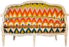 Bold, colorful chevrons on this French settee w/ Schumacher fabric. Definitely a modern take for the old frame.