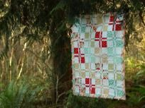 Sweetie-Pie Quilt $45.00  Soft and cuddly flannel, with rich reds and turquoies. Baby feet and hands backing.    Measures 34 X 40    Makes a wonderful new baby gift!