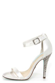 Check it out from Lulus.com! Are those wedding bells we hear? Or did you just fall in love with the Betsey Johnson SB-Bells Ivory Satin Rhinestone Dress Sandals?! These stunning sandals in white satin pair a simple toe and ankle strap combo with a cupped heel, then add the chicest wraparound ankle strap, which adjusts with a silver buckle (and hidden elastic). 4.5