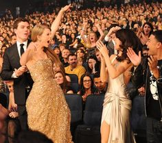 Taylor Swift and Selena Gomez celebrate Swift's win at the American Music Awards on Nov. 20, 2011, in Los Angeles.