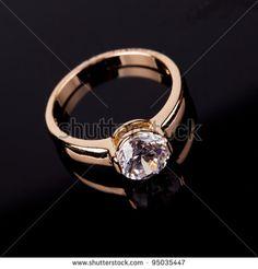 wedding ring with stone on black background