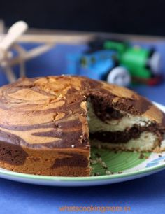 Eggless marble cake is quite similar to sponge cake. We just add alternate layers of vanilla and cocoa batter. The cake looks really very appealing Eggless Marble Cake Recipe, Eggless Chocolate Cake, Eggless Desserts, Marble Cake Recipes, Eggless Recipes, Eggless Baking, No Dairy Recipes, Dessert Recipes, Egg Desserts