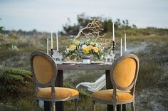Nestled in the sand dunes next to the Monterey Bay, where the forest meets the sea, today's stunning editorial is filled with all the right elements for throwing an elegant seaside affair. Rachel Zee Photography teamed up with Monica of Twigs Floral Design, and together the ladies brought the prettiest beach scene to life. The unique color palette of mustard yellow and sage...