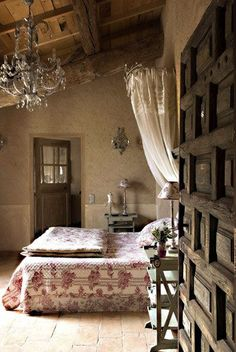 bedroom in Provence--love the ceiling, the chandelier, the paneled door, the muted tones.