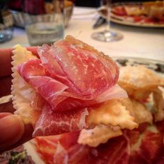 Culatello on gnocco in Reggio Emilia. Culatello is the best of Parma ham. They call it the heart. Gnocco is a type of fried bread in the same shape as ravioli - Instagram by thetravelbite