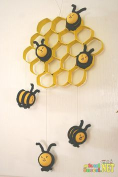 The Bee Tree craft: toilet paper tubes, plastic eggs, pipe cleaners, and wax paper for wings