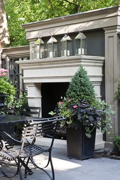 Outdoor fireplace flanked by wonderful garden urns