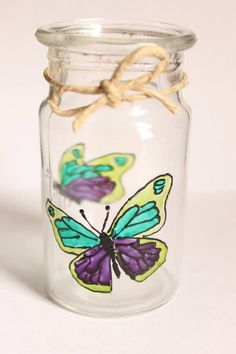 Perfect and unique gift for any occasion.  Small vase, painted with transparent glass paint with two butterflies, one on each side and decorated with bow made from rope.  Measurements: Height - 9 cm/3.54 inches Width - 5 cm/1.97 inches  Handmade, painted with transparent colors for glass, so they can be washed. I recommend hand washing with non-abrasive materials to preserve color.