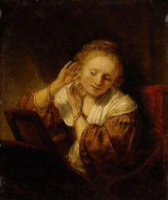 Rembrandt - Young Woman Trying on earrings, 1657