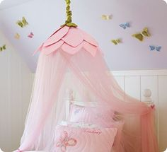 Perfect decoration for your little girl. A flower canopy. You could do this in almost any color to match your child's favorite.