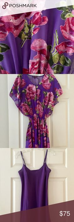 """Beautiful Betsey Johnson tunic dress size P 2-4 Absolutely gorgeous purple and hot pink """"vintage"""" Betsey Johnson tunic dress. Size P fits 2-4. Sheer purple tunic with stunning hot pink/shades of pink roses with a purple slip underneath. Wear is a short mini or pair with leggings - great for a party or the upcoming holidays. I say this is """"vintage"""" because I bought it 5-6 years ago from the store when she still had store front locations! Perfect condition! It's a stunner!! Betsey Johnson Tops…"""